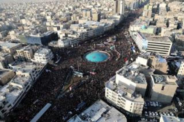 A drone photo shows thousands of Iranians attending the funeral ceremony of General Qasem Soleimani