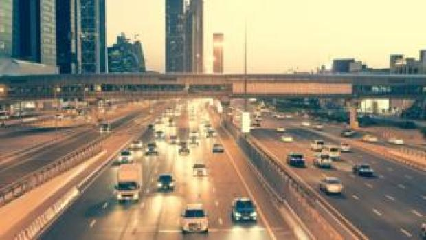 Skyscraper roads and bridge at the Sheikh Zayed Road in Dubai in the evening