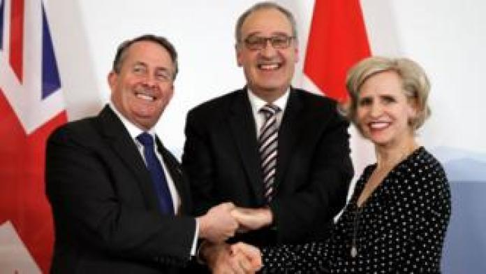 Liam Fox, the Swiss Minister of Economic Affairs Guy Parmelin and the Liechtenstein Foreign Minister shaking hands