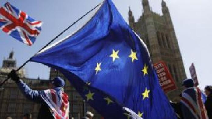 The EU and union flag outside Parliament