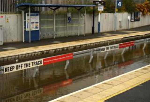 Flood water covering the rail tracks at Rotherham Central train station