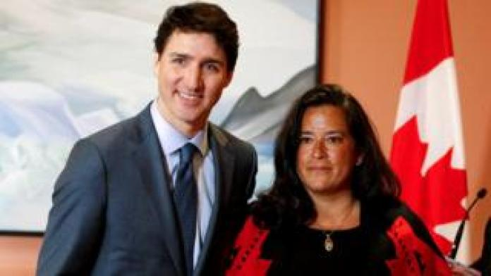 Newly appointed Veterans Affairs Minister Jody Wilson-Raybould poses with Prime Minister Justin Trudeau