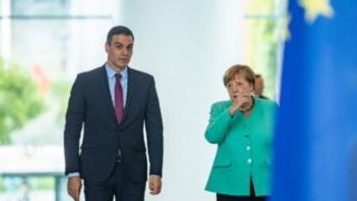 German Chancellor Angela Merkel and Spanish Prime Minister Pedro Sanchez arrive for a joint press statement