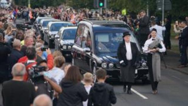 The funeral cortege arrives in Ashington greeted by well-wishers