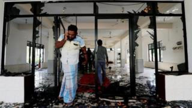 A Muslim man reacts inside the Abbraar Masjid mosque after an attack in Kiniyama