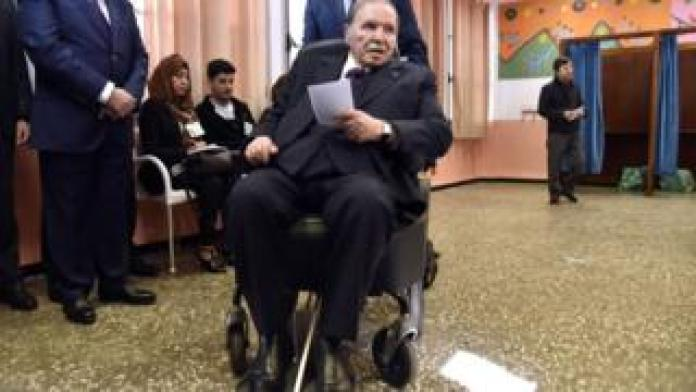 Algerian President Abdelaziz Bouteflika can be seen while voting at a polling station in April 2017