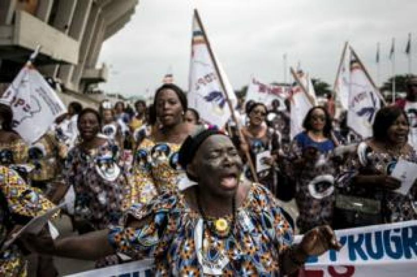 Supporters of former DR Congo Prime Minister and opposition leader Etienne Tshisekedi sing and dance ahead of his mourning ceremony.
