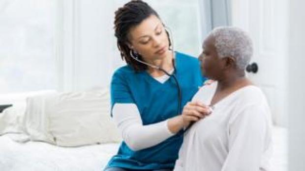 A nurse and a cancer patient