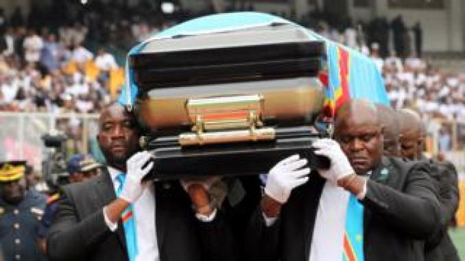 Pallbearers carry the casket with the remains of Etienne Tshisekedi, former Congolese opposition figurehead who died in Belgium two years ago, at a mourning ceremony at the Martyrs of Pentecost Stadium in Kinshasa on 31 May.