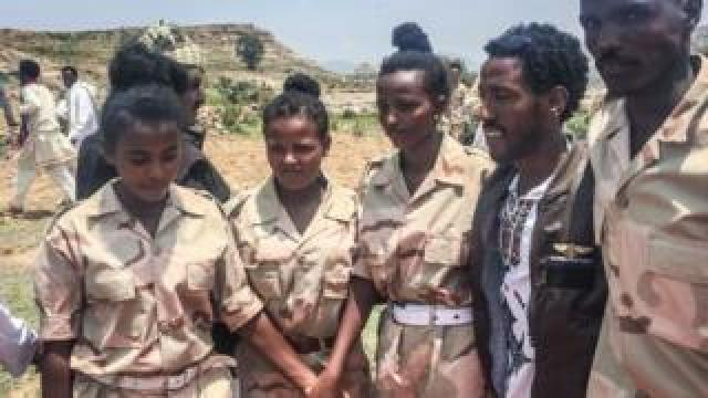 Eritrean soldiers react on September 11, 2018 in Serha, Eritrea, as two land border crossings between Ethiopia and Eritrea were reopened for the first time in 20 years in Serha
