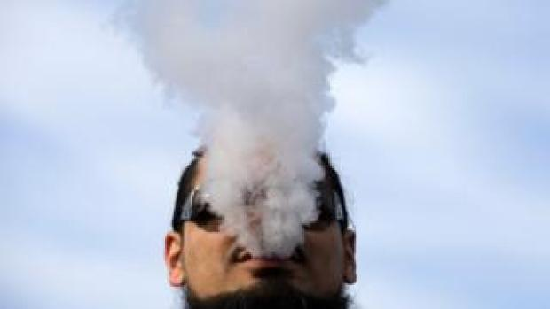 A man vapes during a rally to protest the proposed vaping flavor ban in Washington DC