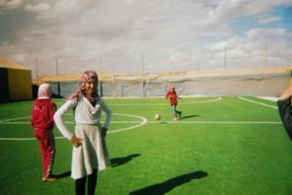 sport Girls train on a football pitch