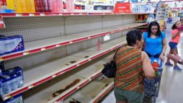 Nearly empty shelves are shown at a grocery store as Tropical Storm Dorian approaches in Cabo Rojo, Puerto Rico