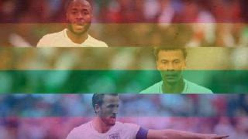 Raheem Sterling, Dele Alli and Harry Kane behind an LGBT flag