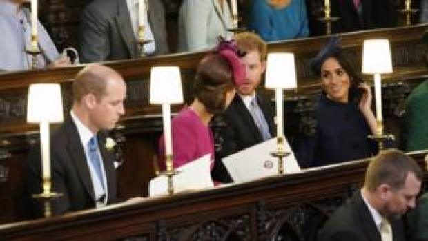 """The Duke and Duchess of Cambridge (left) and the Duke and Duchess of Sussex (right) take their seats ahead of the wedding of Princess Eugenie to Jack Brooksbank at St George""""s Chapel in Windsor Castle. PRESS ASSOCIATION Photo. Picture date: Friday October 12, 2018. See PA story ROYAL Wedding. Photo credit should read: Danny Lawson/PA Wire"""