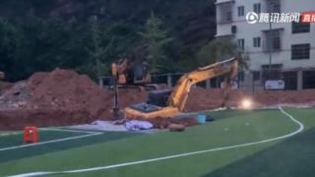 Chinese television aired footage of investigators digging up the school's running track