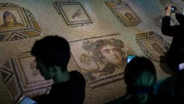 Visitors photograph missing pieces of the mosaic - 8 December