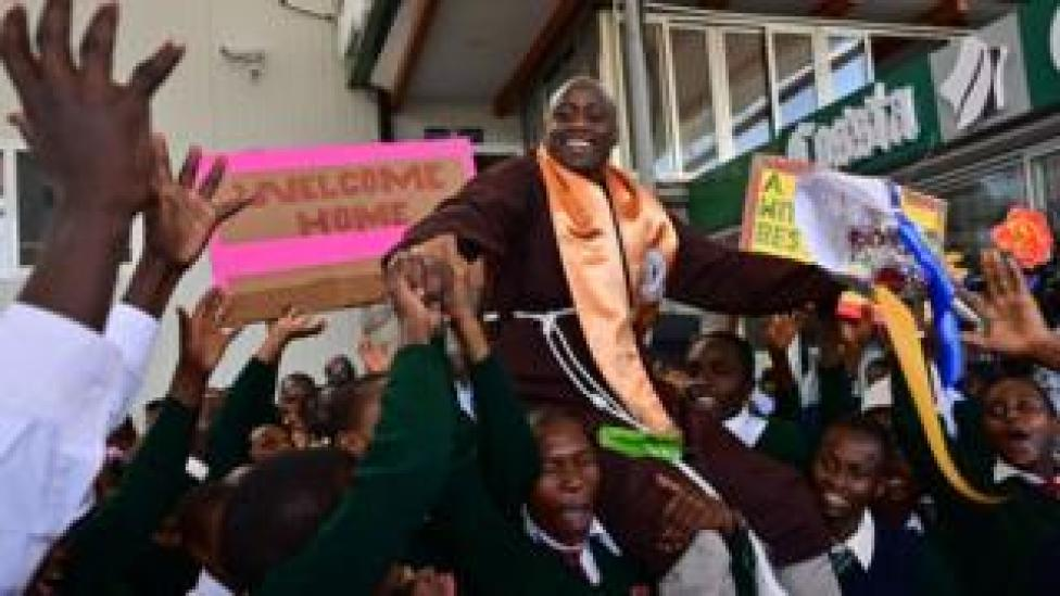 Peter Mokaya Tabichi (top), is welcomed by his students on March 27, 2019 upon arrival at Nairobi's Jomo Kenyatta Airport from Dubai.