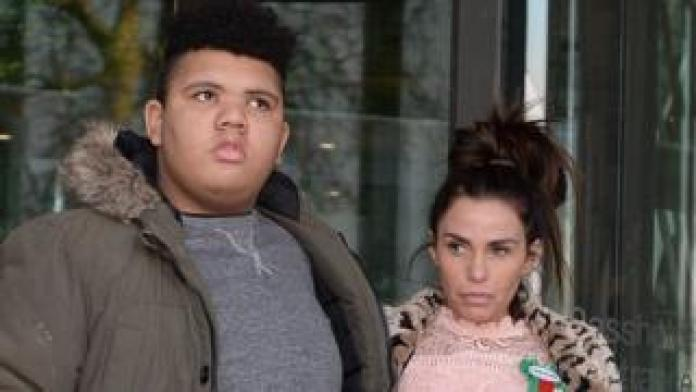 Katie Price with her son Harvey leave Portcullis House in London after giving evidence to the Commons Petitions Committee where she called for online abuse to be made a specific offence.