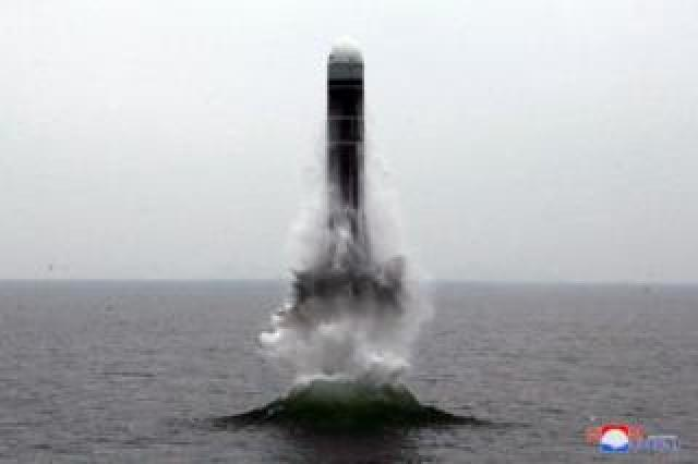 What appears to be a submarine-launched ballistic missile (SLBM) flies in an undisclosed location in this undated picture released by North Korea's official news agency