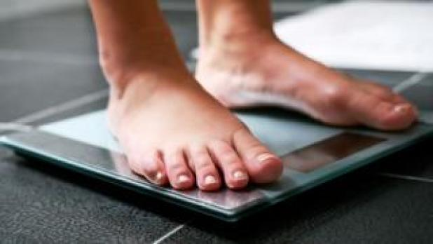 A person standing on scales