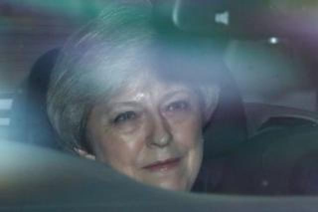 Theresa May in a car