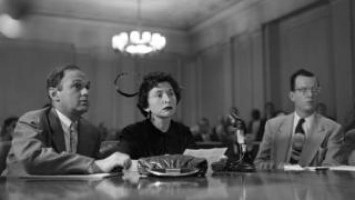An American woman testifies to the committee