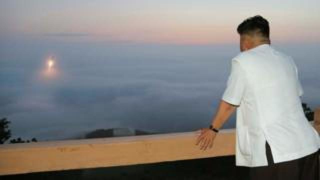 Kim Jong-un watches a missile launch (July 2014)