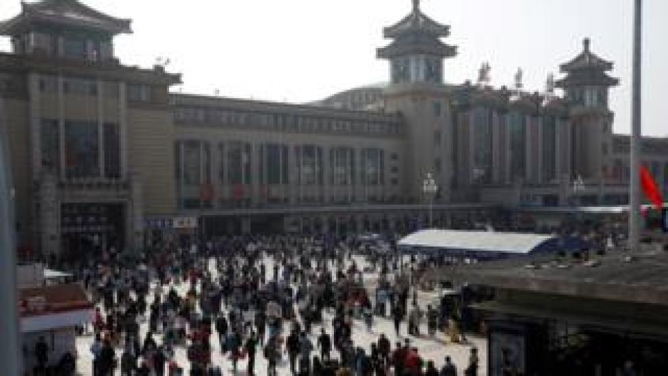 People outside Beijing Railway station
