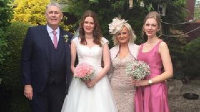 Ali with his wife and daughters on Alison's wedding day