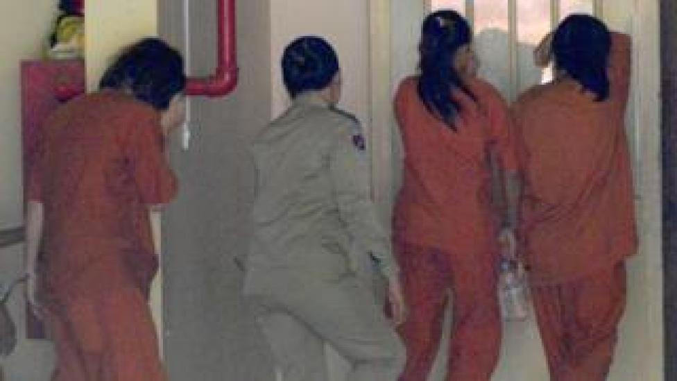 Women detainees escorted by Cambodian police arrive at the Phnom Penh municipal court for sentencing over commercial surrogacy, 3 August 2017