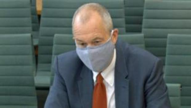 Sir Patrick Vallance wearing a mask as he gives evidence to the science and technology committee