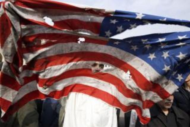 A US flag is defaced during an anti-US demonstration