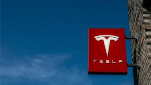 Logo of a Tesla Motors store in Hangzhou downtown. Tesla Motors is an American automotive and energy storage company selling luxury electric cars and battery products. It aims to produce its $76,000 and up vehicles in China