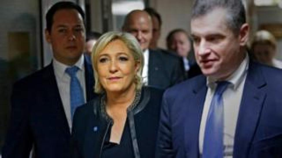 French presidential candidate Marine Le Pen (C) and Russian State Duma international affairs committee head Leonid Slutsky