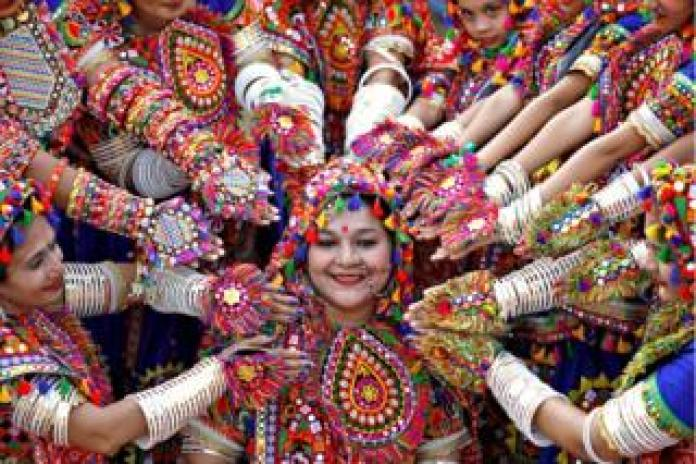 Participants dress in traditional attire and rehearse for a festival