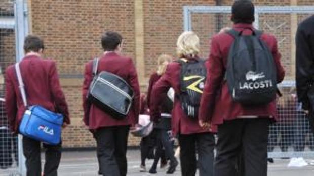 Pupils walking through a school playground