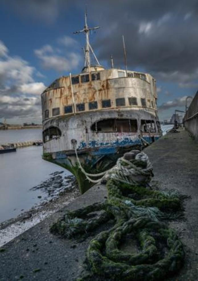 Derelict ship at a harbour