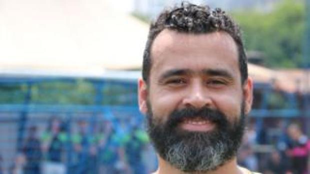 Douglas Braga poses for the camera at a LGBT football tournament