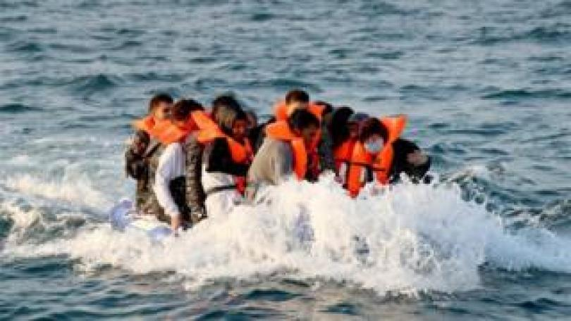 A group of people thought to be migrants crossing the Channel in a small boat headed in the direction of Dover