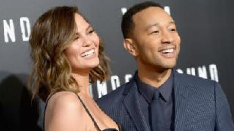 Chrissy Teigan and John Legend photographed together at event in March 2017
