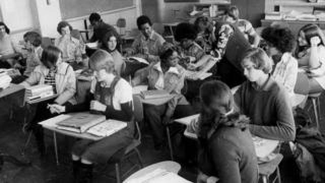 An initiative to desegregate Boston Public Schools was implemented in the fall of 1974 and was met with strong resistance from many residents of Boston's neighborhoods