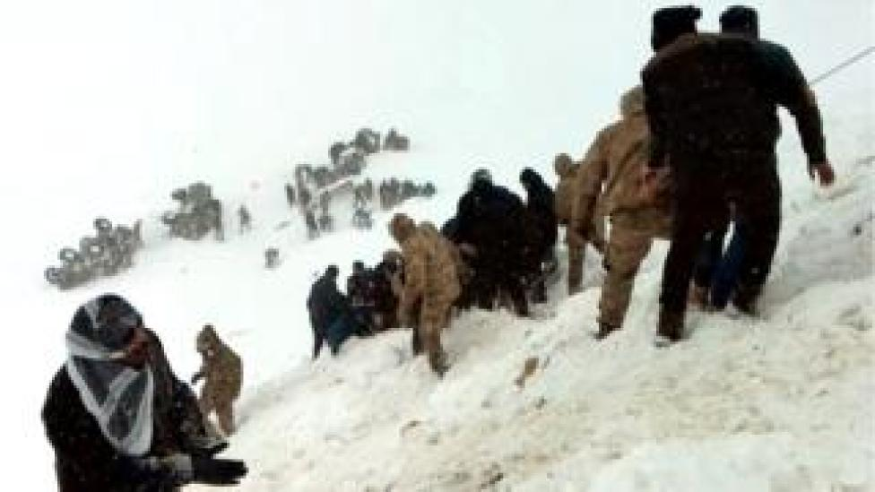 Turkish soldiers and locals try to rescue people trapped under snow following an avalanche in Bahcesaray in Van province, Turkey, 5 February 2020