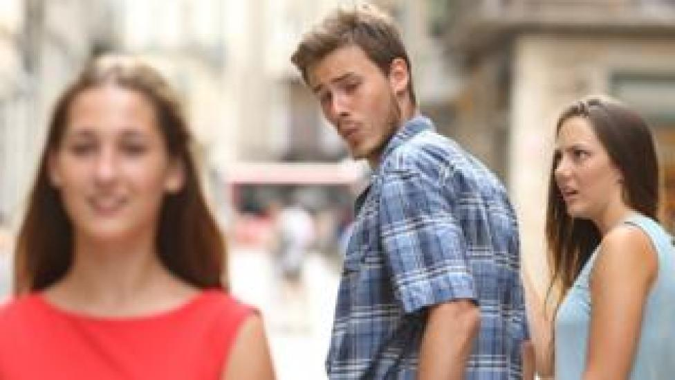NEWS A distracted boyfriend looks at another woman while his girlfriend looks on in disgust