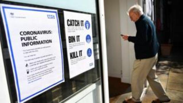 An elderly man walks into a NHS centre testing for coronavirus London