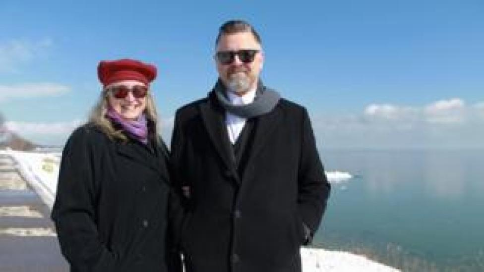 Tina and Jason Prigge stand in front of Lake Michigan