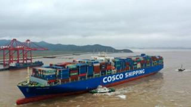 Aerial view of a Cosco France container ship berthing with the help of tugboats at the Port of Ningbo-Zhoushan on September 1, 2019 in Zhoushan, Zhejiang Province of China.