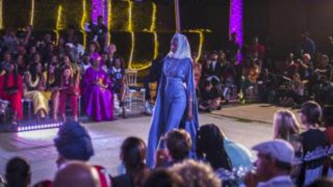 A model walks on a catwalk wearing a design from Senegalese fashion label So' Fatoo during Dakar Fashion Week in Dakar, Senegal