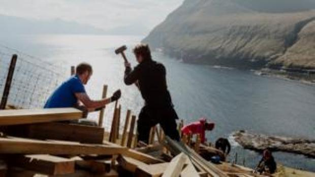 Pink Group members build steps in Gjógv