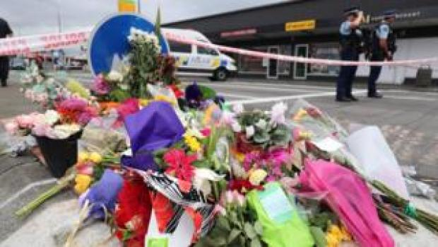 Flowers laid at police cordon near scene of shooting in Christchurch on 15 March 2019
